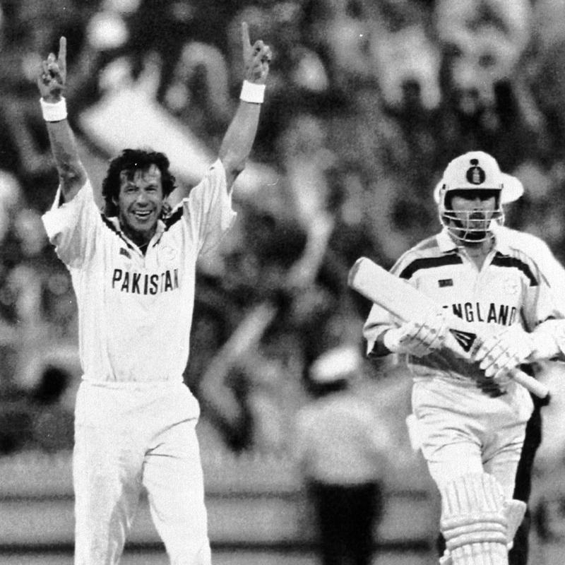Pakistan captain Imran Khan raises his arms in triumph