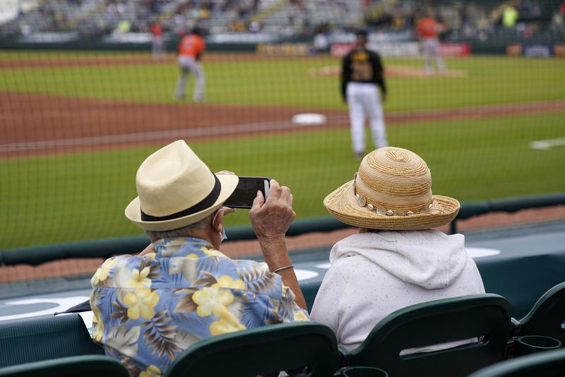 Fans take photos at spring training game