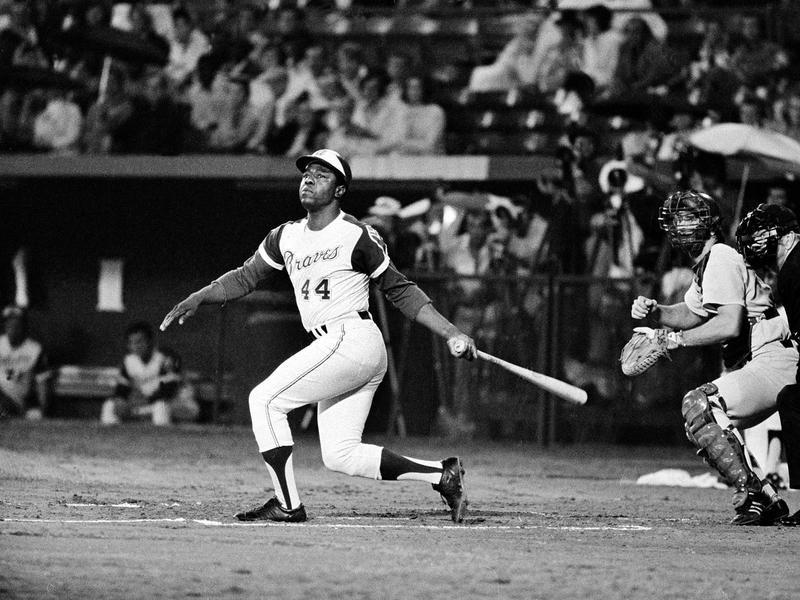 Atlanta Braves' Hank Aaron watches flight of his long ball
