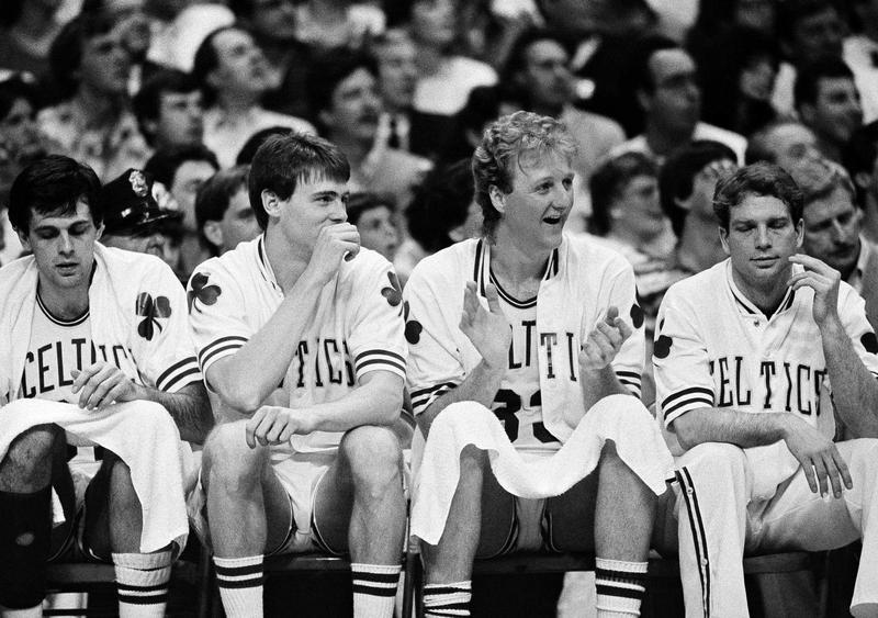 Boston Celtics' Larry Bird cheers on team from bench