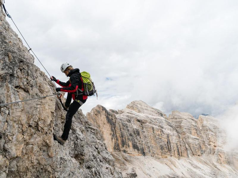 Climber on Via Ferrata, Dolomites, Italy