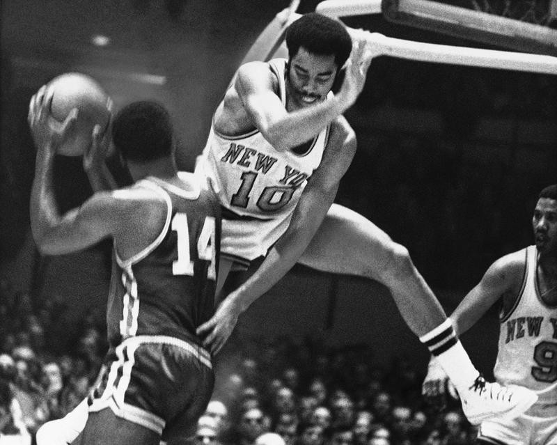 Walt Frazier jumps into the air