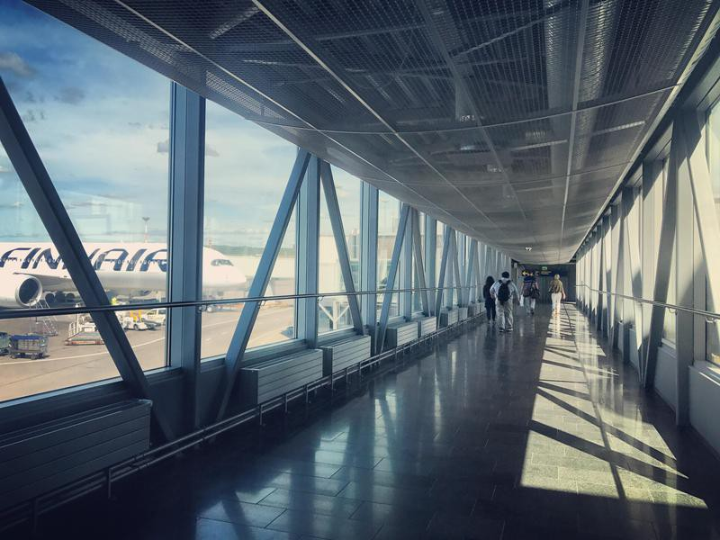 Passengers walking through the airport gate in Finland
