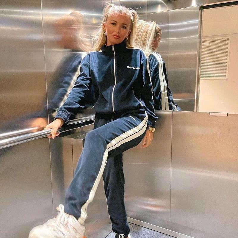 Woman posing in a track suit