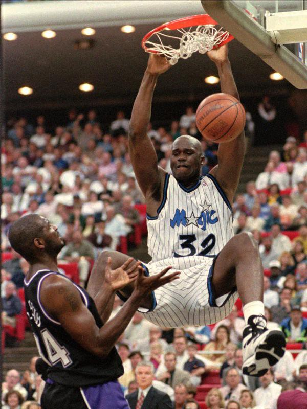 Shaquille O'Neal dunks