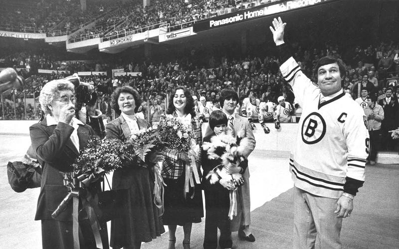 John Bucyk waves to Bruins fans after his No. 9 was retired