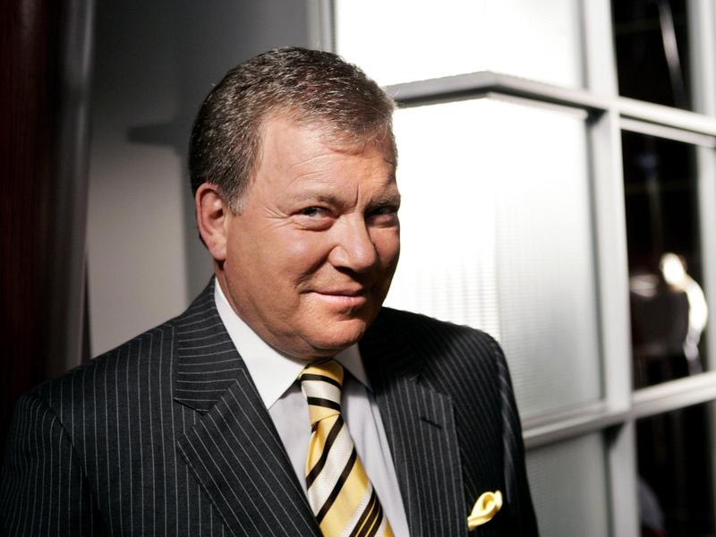 """Shatner poses on the set of """"Boston Legal"""" in 2004. His work in Hollywood extended behind the scenes, too."""