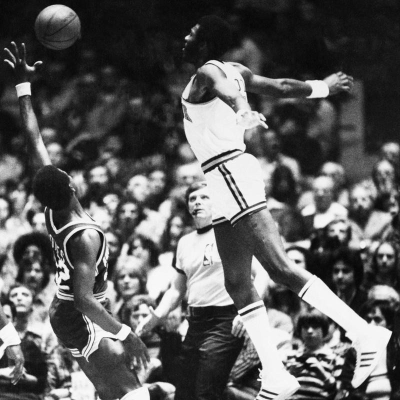 New York Knicks' Bob McAdoo appears to be flying with arms spread