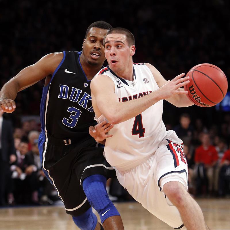 T.J. McConnell drives against Duke's Tyler Thornton