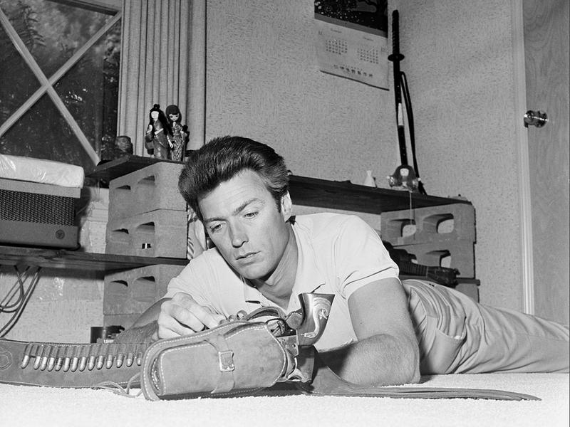 Clint Eastwood loads his new Colt revolver at his home in Los Angeles in 1962.