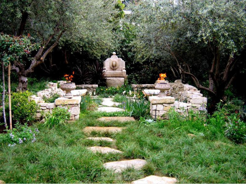 Home garden with stone pathway, stone walls and fountain