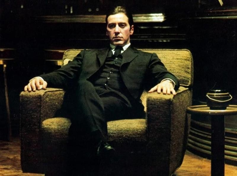 Al Pacino sitting in The Godfather, Part II