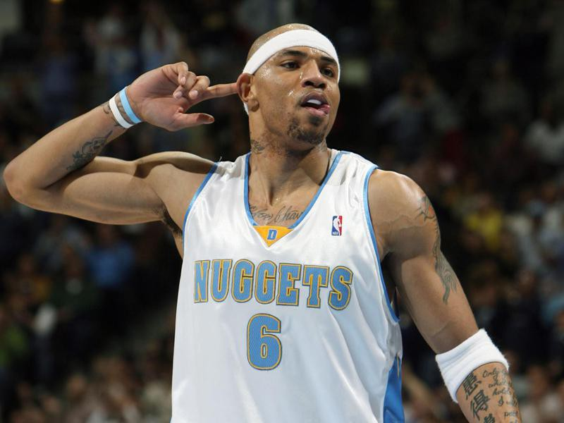 Kenyon Martin gestures to the crowd