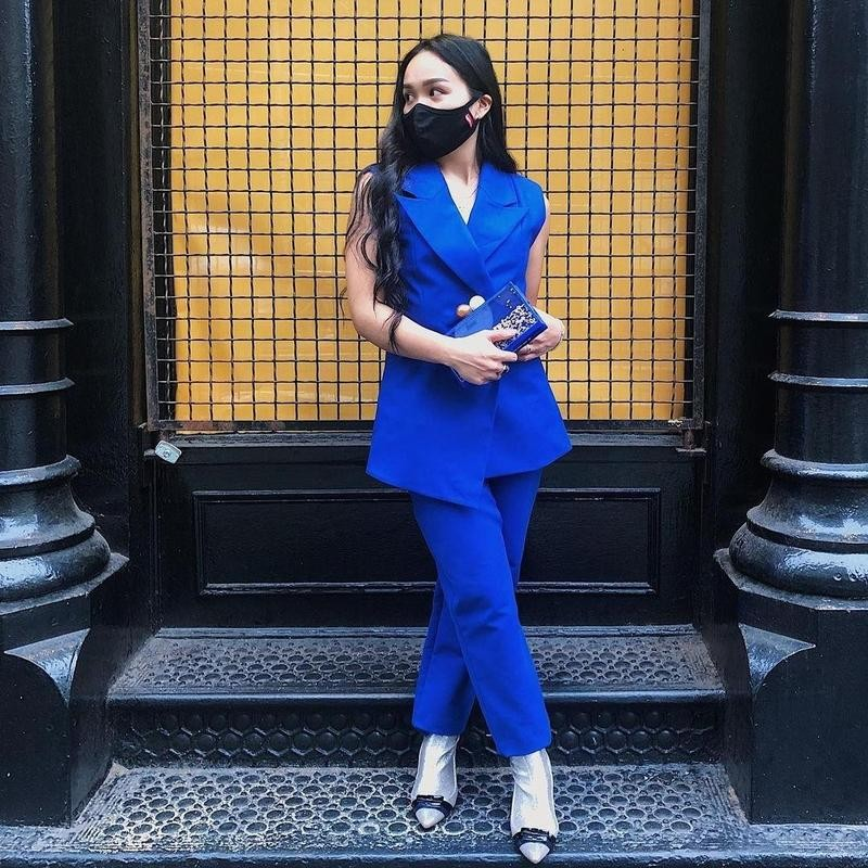 Woman poses in blue suit