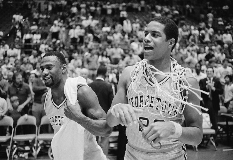 Georgetown's Gene Smith and Fred Brown celebrate after beating Dayton