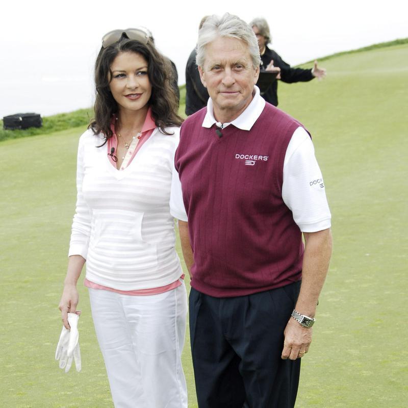 Actress Catherine Zeta-Jones and Michael Douglass on golf course