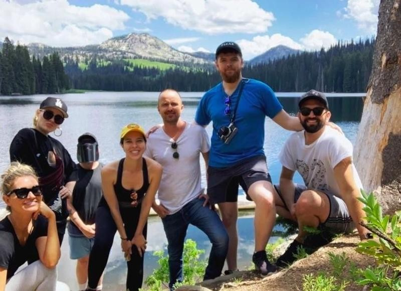 Aaron Paul poses at scenic lake in Idaho
