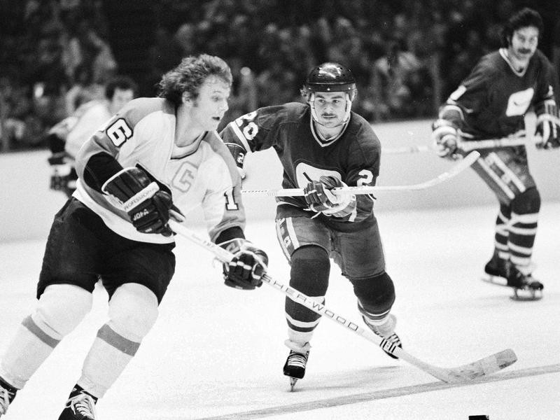Bobby Clarke takes puck down ice
