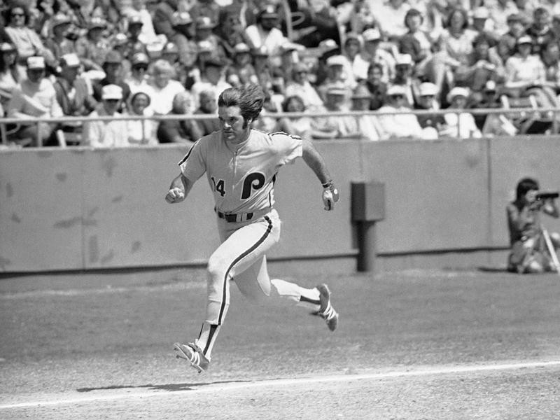 Pete Rose runs hard for home plate