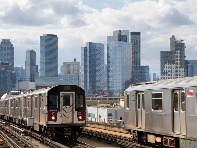 Two Subway Trains Speeding on Elevated Track in Queens, New York