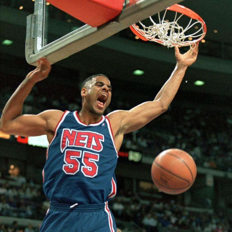 New Jersey Nets' Jayson Williams yells out after dunking