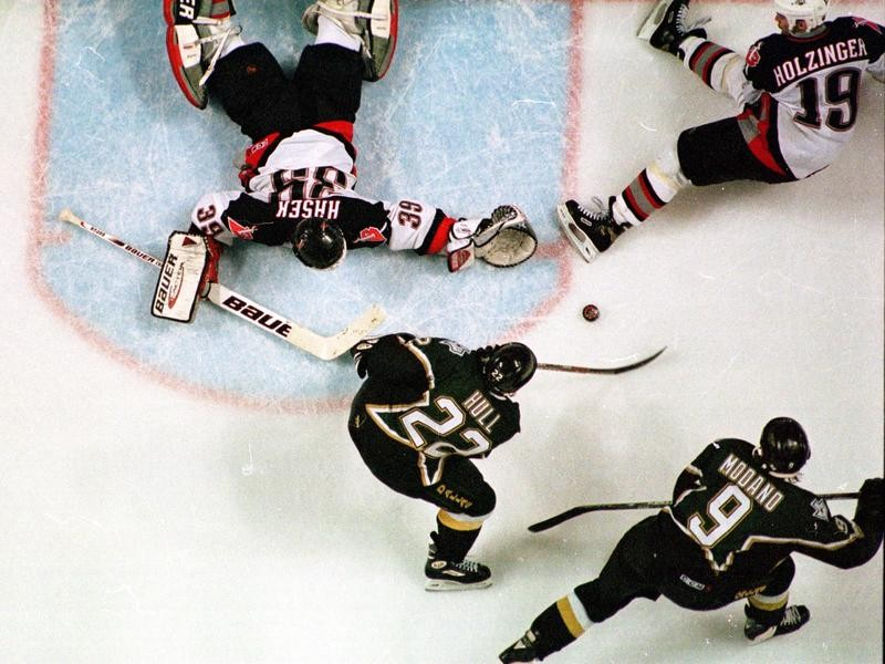 Brett Hull of the Dallas Stars shoots game winning goal against Buffalo Sabres in Stanley Cup Finals