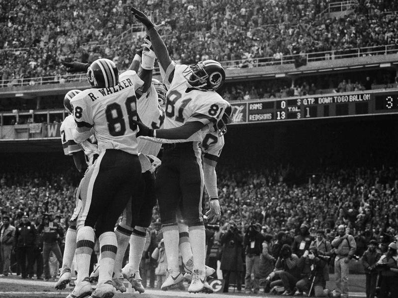 Fun Bunch high-fives in end zone