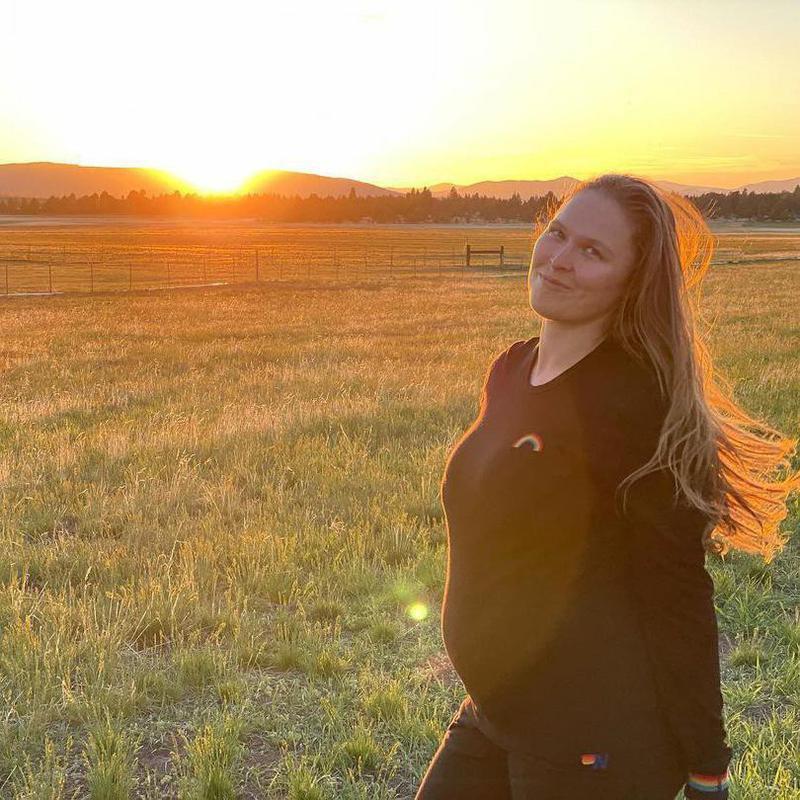 Ronda Rousey posing at sunset