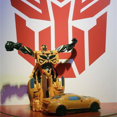 """A new """"Mega One-Step Bumblebee"""" Transformer is displayed at the Hasbro showroom during the American International Toy Fair in New York, Tuesday, Feb. 18, 2014. (AP Photo/Seth Wenig)"""