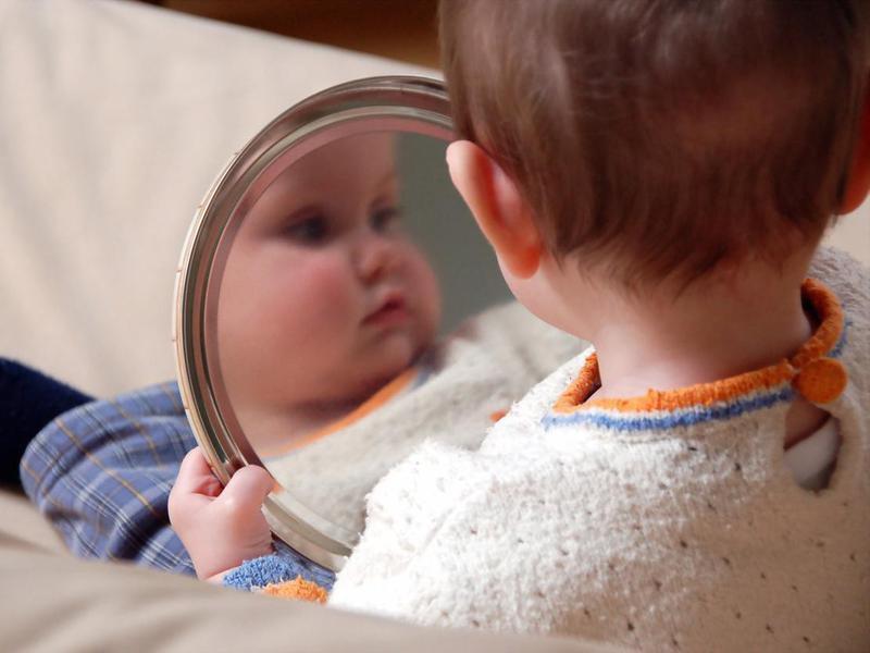 Baby looking at mirror