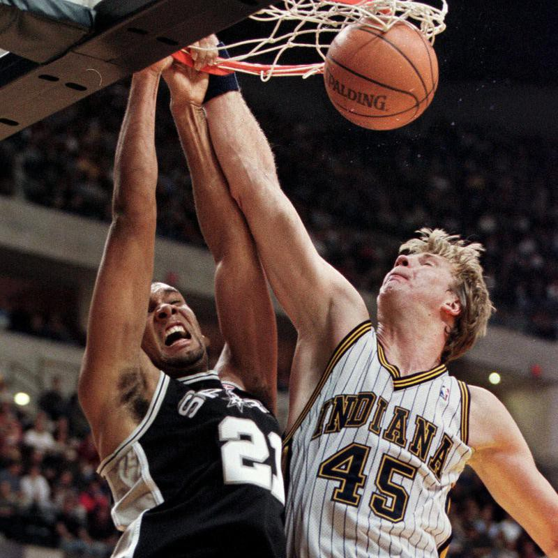 Tim Duncan slam dunks ball