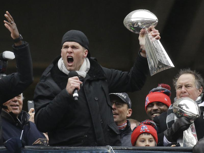 Tom Brady with a Super Bowl trophy