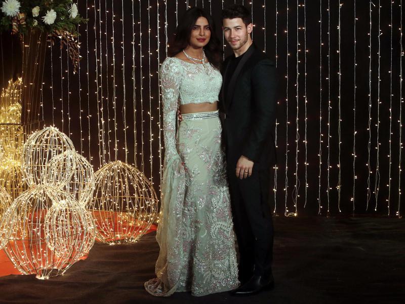 Priyanka Chopra and Nick Jonas pose for photographs