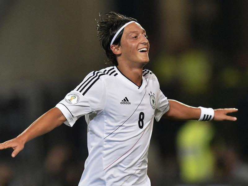 Mesut Özil celebrates after scoring a goal in a 2014 World Cup qualifying match between Germany and Faroe Islands.
