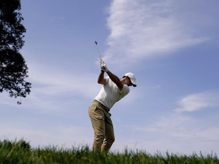 Rory McIlroy hits on third green