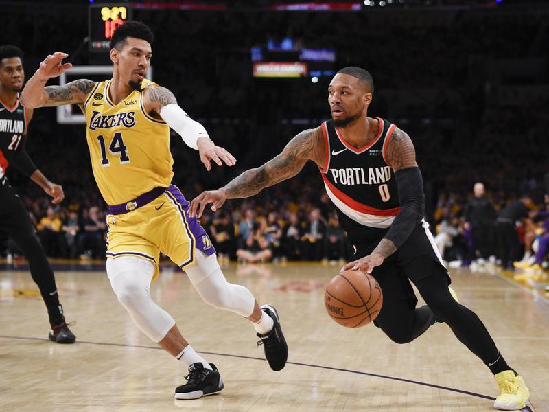 Portland Trail Blazers guard Damian Lillard drives to basket