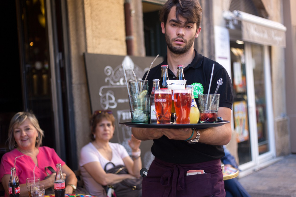 A waiter serving beer in France