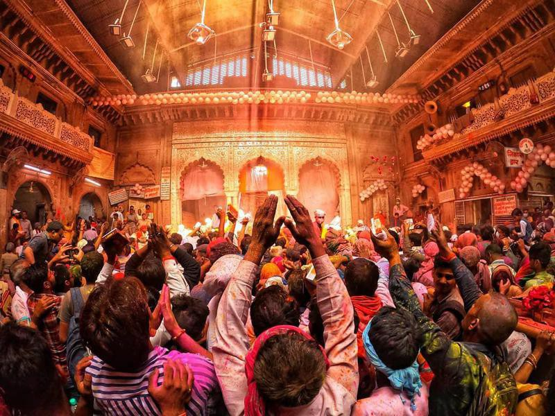 People celebrating Holi in a temple