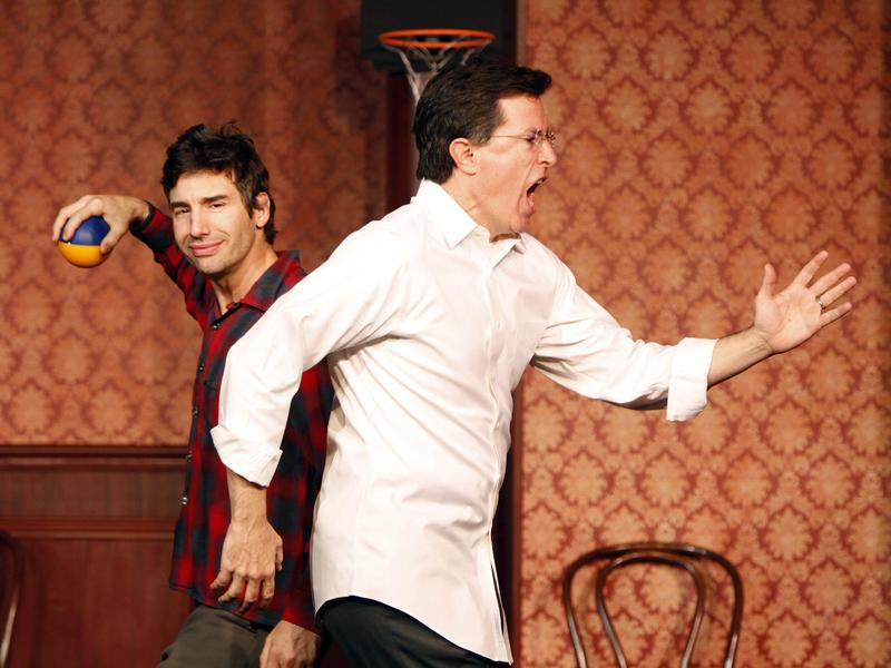 Stephen Colbert (right) and actor Paul Dinello perform at The Second City's 50th anniversary in Chicago in 2009.