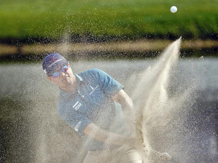Zach Johnson blasts from sand trap