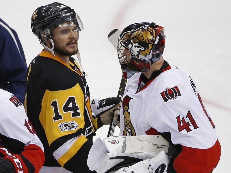 Chris Kunitz of the Pittsburgh Penguins and Craig Anderson of the Ottawa Senators meet in handshake line