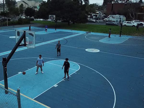 Kids playing at Mosswood Park Basketball Courts