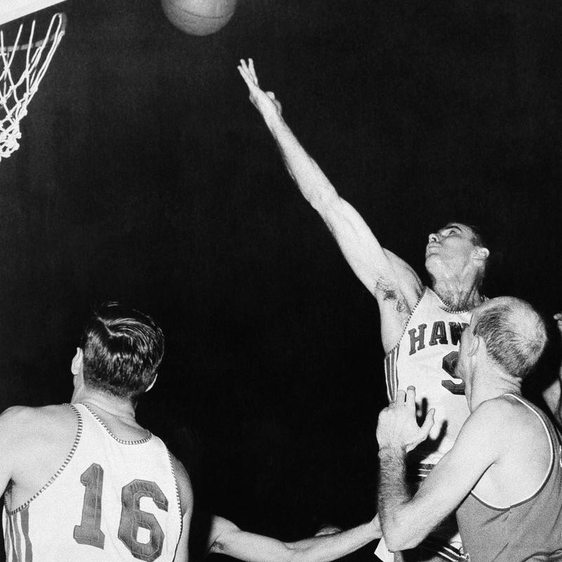 Bob Pettit lets the ball roll off his fingers for two pointer