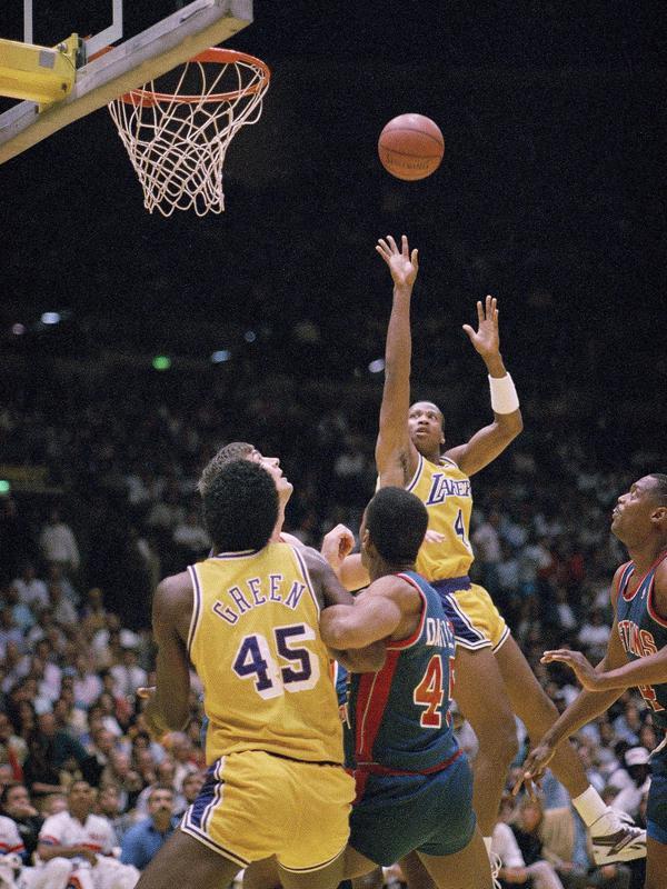Byron Scott goes up for basket