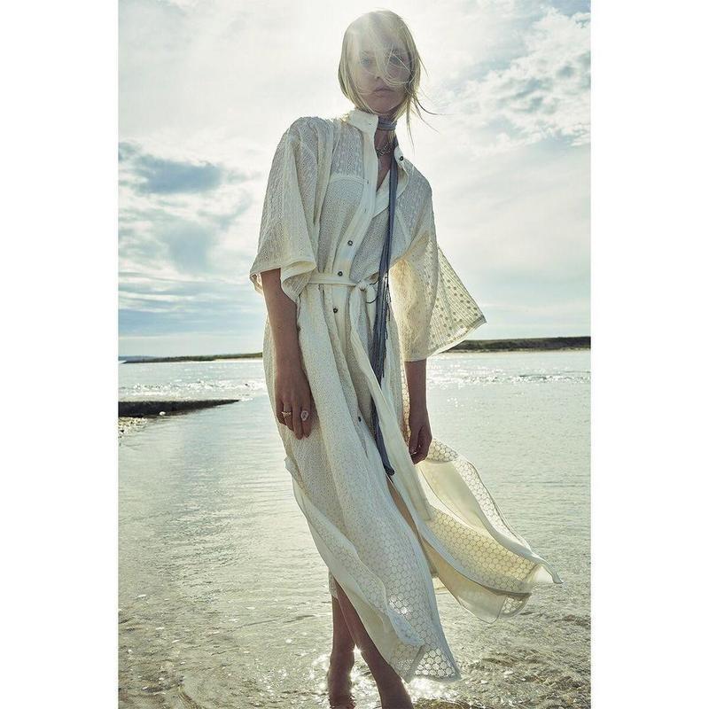 Woman in dress by beach