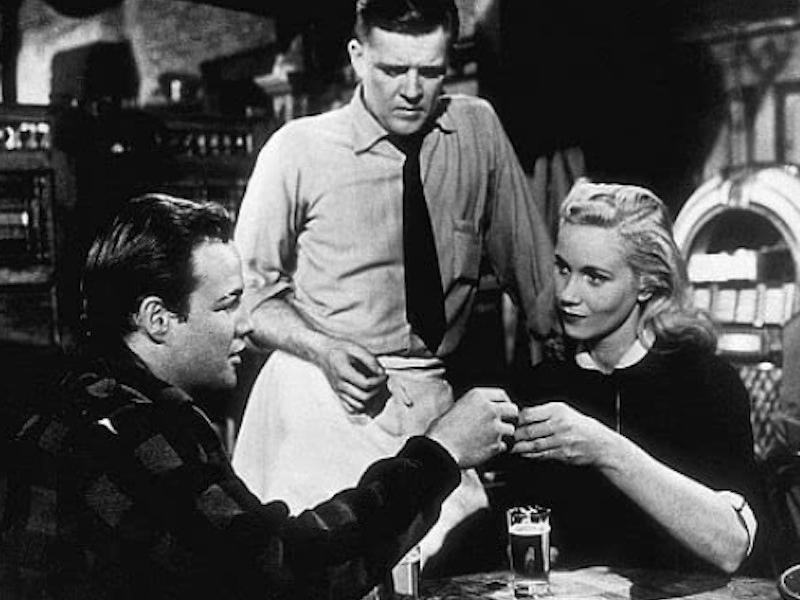 Marlon Brando, Eva Marie Saint holding drinks in On the Waterfront