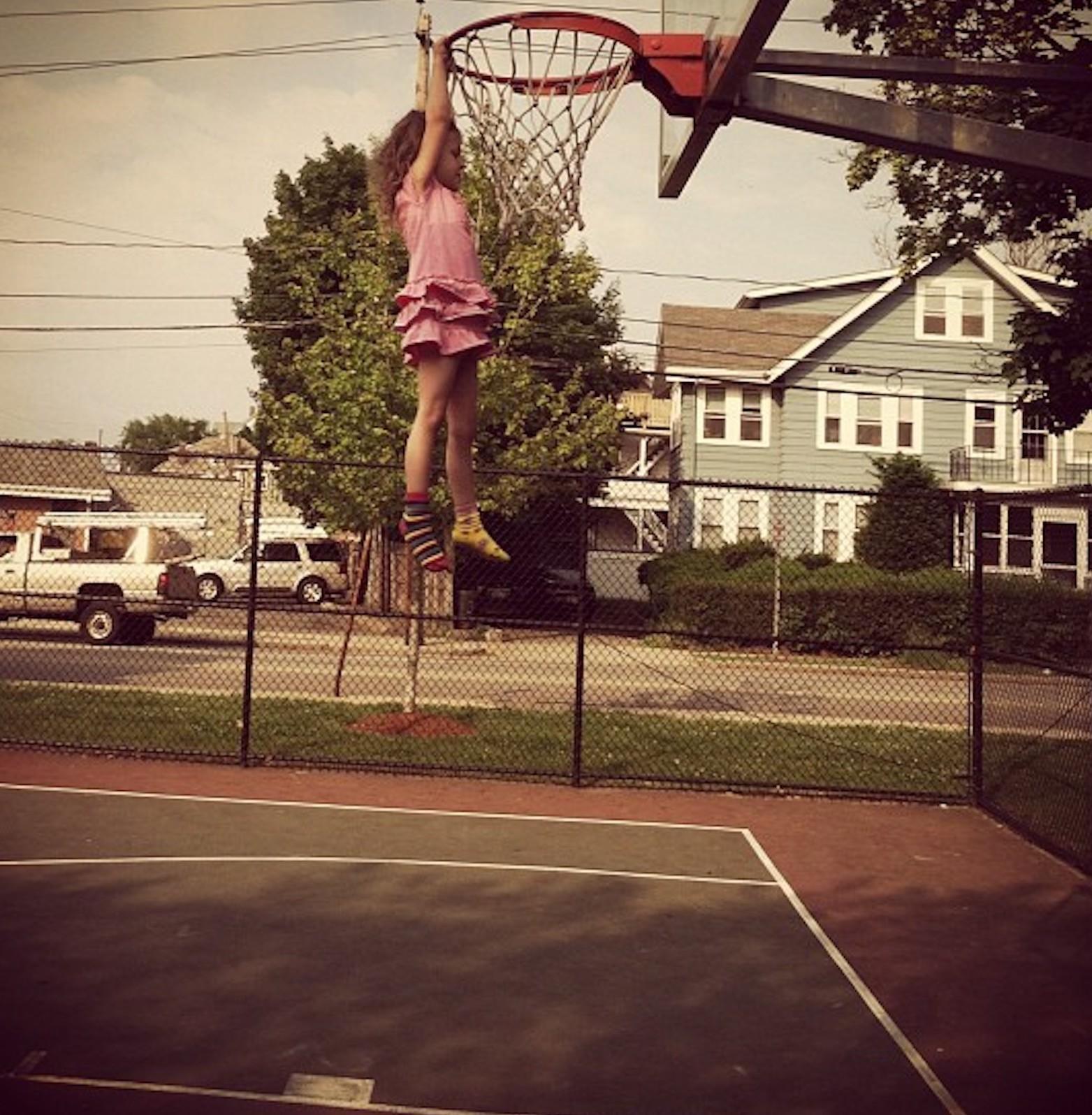 Hanging on a basketball hoop