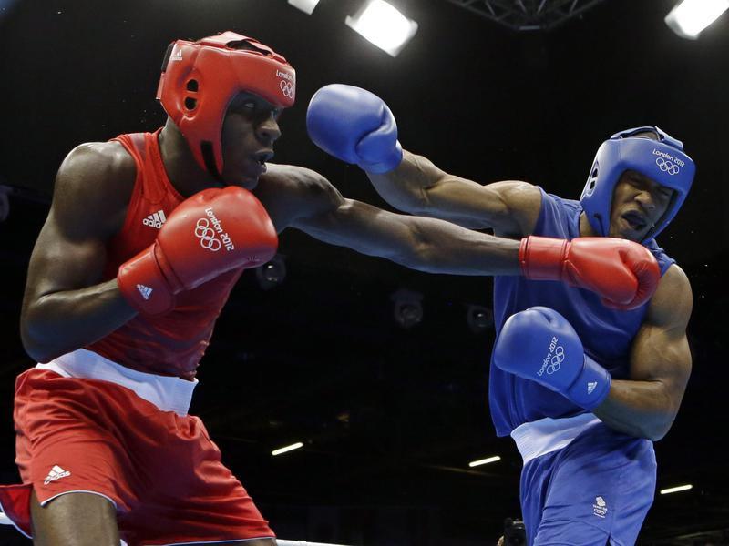 Britain's Anthony Joshua fights against Erislandy Savon Cotilla