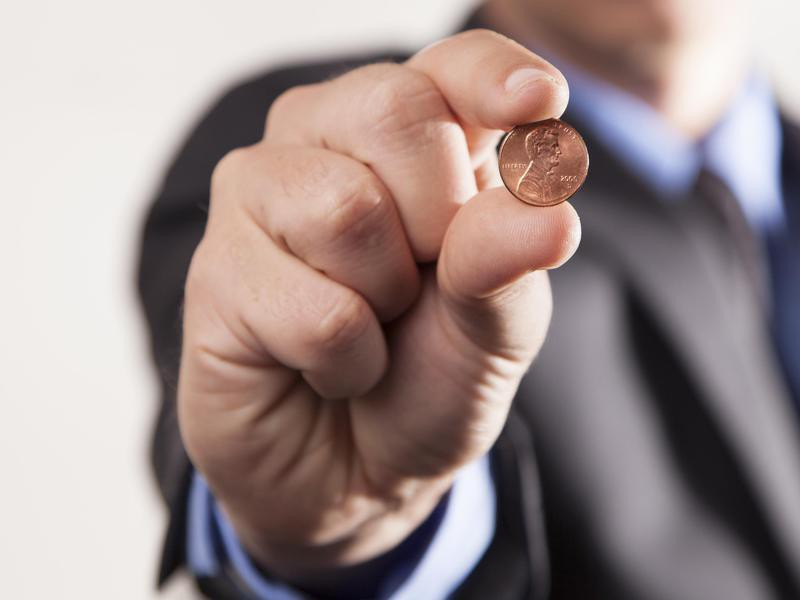 Man holding a penny
