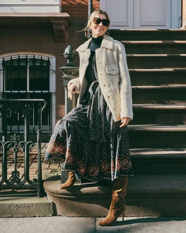 Woman in print dress by stoop steps